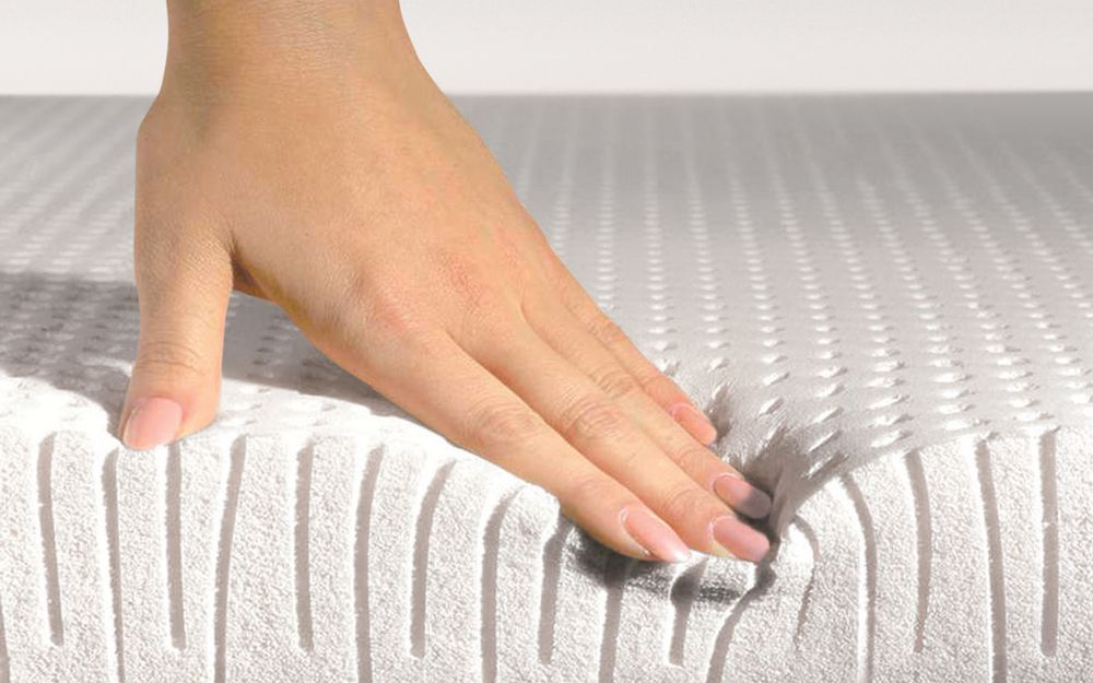 hand on latex mattress
